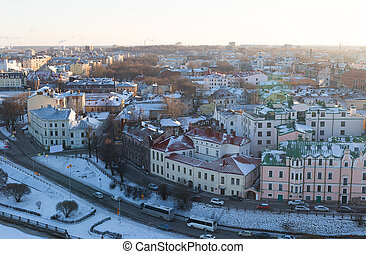 panoramic view of the snow-covered Vyborg with colorful houses roofs on the banks of the river embankment was a bright sunny day