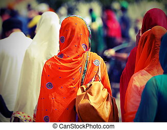 Sikh women with veils over their heads during the procession...