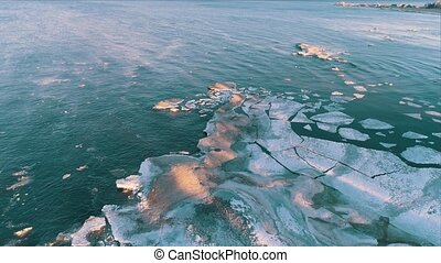 Aerial View Frozen Shapes of Ice Floating on Lake Ladoga,...