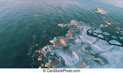 Aerial View Frozen Shapes of Ice Floating on Lake Ladoga