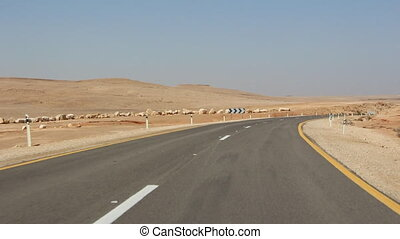driving through the desert - Shot of driving through the...