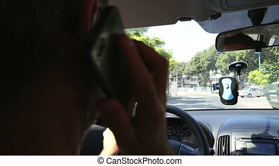 Driver taking a call while driving - Shot of Driver taking a...