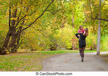 Family walking away - Mom is carrying away her daughter (3...