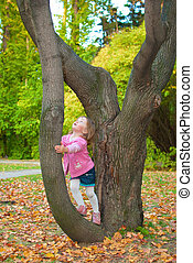 Autumn walk 1 - Little girl 3 years old leaned to a tree and...