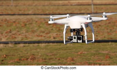 Drone with camera attached landing - Shot of Drone with...