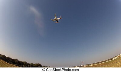 Drone with camera attached in the field - Shot of Drone with...