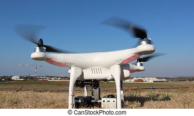 White Drone with camera attached - Shot of White Drone with...