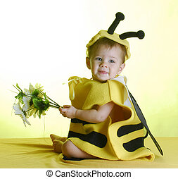 baby dressed up like a bee - cute baby wearing bee costume...