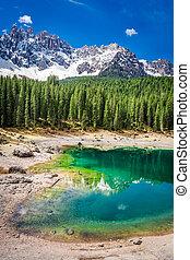 Sunny day in mountain Carezza lake in Dolomites, Italy,...