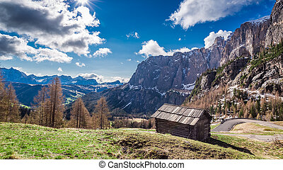 Small old wooden house in the Dolomites, Italy, Europe