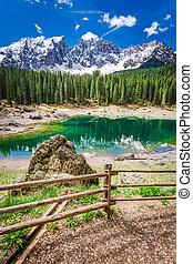Mountain Carezza lake in spring, Alps, Italy, Europe