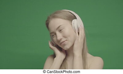 Happy Girl Listen Music in White Headphones