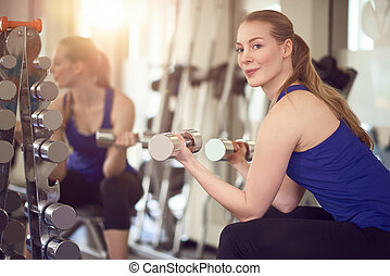 Fit healthy woman working out with weights