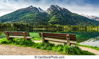 Two wooden bench at Hintersee lake in the Alps, Europe