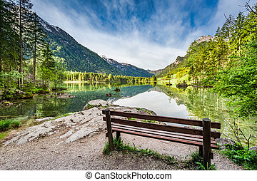 Small bench at the Hitersee lake in the Alps, Europe
