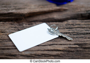 House key and keycard on wooden floorboards - House key and...