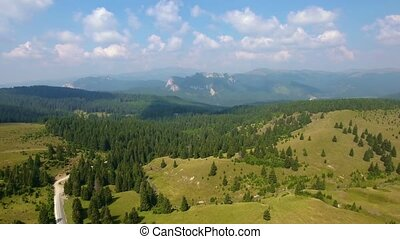Aerial shot of narrow valley and mountains - Aerial View....
