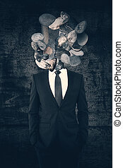 Rock headed man on concrete background