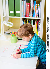 Little boy studying at home