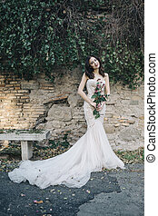 Bride fashion with romantic flower bouquet in Rome -...