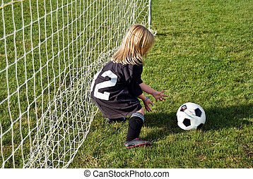 Soccer Goalie - Little girl playing soccer.