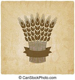 sheaf of wheat with ribbon vintage background. vector...