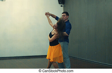 A couple dancing in the hall - Dance classes. A couple...