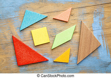 pieces of wooden tangram puzzle - seven colorful tangram...