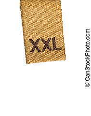 Macro of XXL size clothing label on white