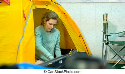 young girl in a specialty store for the tourism picks tent...