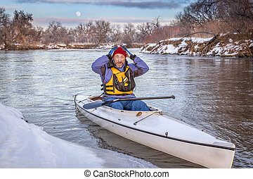 winter canoe paddling in COlorado