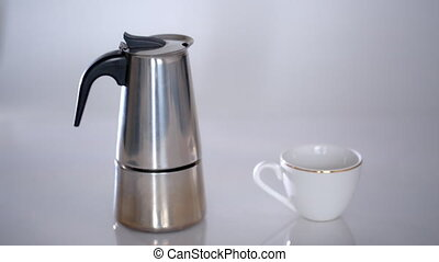 geyser coffee maker and a white coffee Cup isolated on...