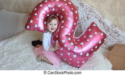 Cute 2 year old girl's birthday. Balloons
