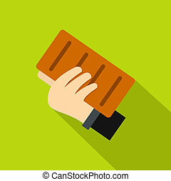 Hand holding a brick icon, flat style - Hand holding a brick...