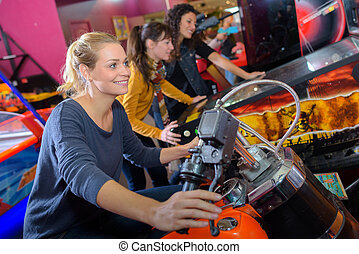 Woman on arcade motorcycle