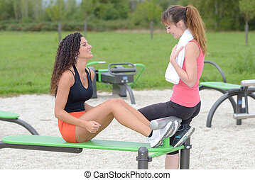 Woman using outdoor exercise equipment
