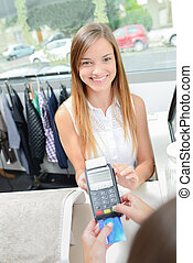 girl paying with card