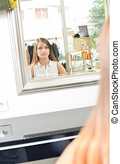 Woman waiting to have her hair cut