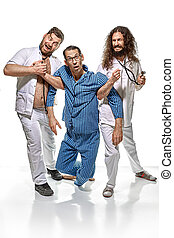 Two psychiatrists holding a lunatic - Two funny...