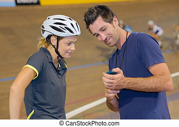 Trainer showing cyclist her time