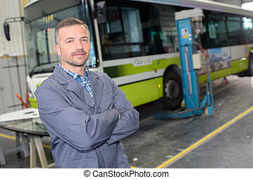 bus mechanic posing