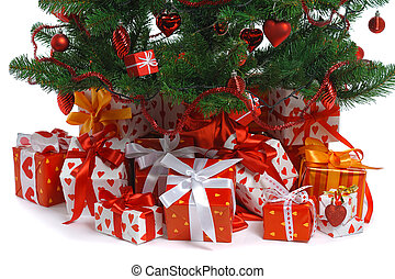 Christmas gifts - heap of red gifts under decorated...