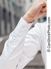Close up of a businessman's shirt cuffs. Closeup of a hand...