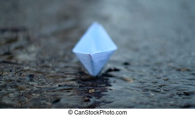 The hand of man launches a paper boat. paper boat - The hand...