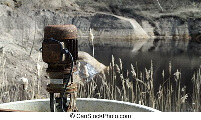 Industrial Mining Abandonded Sump Pump - A rusty old...
