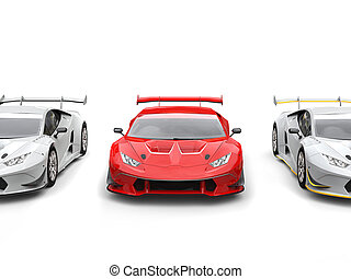 Bright red supercar with white sportscars on each side