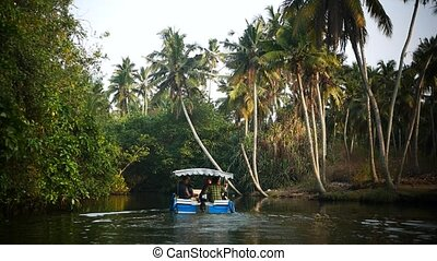 Boat and Palm tree backwater in India - Yoga tour by Yantra...