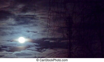 Full moon moving across cloudy sky. Time lapse video. - Full...