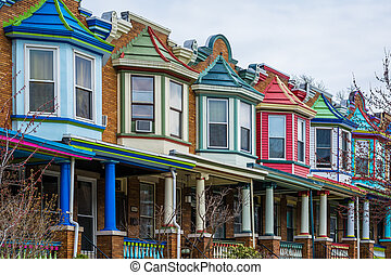 Colorful row houses along Guilford Avenue in Charles...