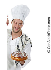 Young attractive caucasian man chef, cake